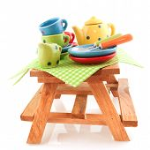 Wooden Picnic Table With Crockery