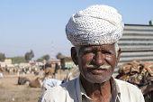 Closeup Of Older Farmer With White Turban.
