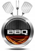 pic of flame-grilled  - Metallic round barbecue symbol or icon with metallic grill and flames kitchen utensils fork and two spatulas - JPG
