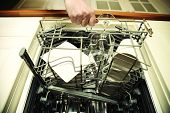 stock photo of dishwasher  - Kitchen Woman with a clean wine glass on background dishwasher - JPG