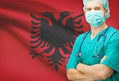 stock photo of albania  - Surgeon with national flag on background  - JPG