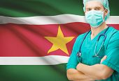 stock photo of suriname  - Surgeon with national flag on background  - JPG