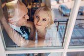 stock photo of adoration  - Bride adoring eyes looking at her husband - JPG