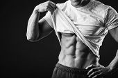 stock photo of abdominal muscle man  - Muscular man bodybuilder - JPG