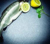 stock photo of fish skin  - Fresh fish with lemonade parsley - JPG