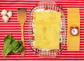 image of lasagna  - Making of tasty Italian lasagna on a bright background - JPG