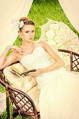 stock photo of wedding arch  - Charming elegant bride under the wedding arch - JPG