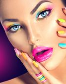 image of long nails  - Beauty Girl face with Vivid Makeup and colorful Nail polish - JPG