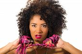 pic of afro hair  - Close up shot of exotic beautiful young girl with dark curly hair posing holding whip isolated on white - JPG