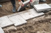 image of pavestone  - Construction worker installing the pavestone on the road - JPG