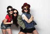 stock photo of three sisters  - Three stylish sexy hipster girls best friends - JPG