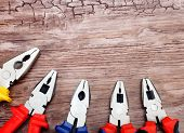 image of pliers  - copyspace image set of handtools pliers on vintage wooden board construction concept - JPG