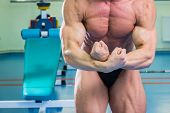 picture of arm muscle  - Bodybuilder showing his muscles in the gym  - JPG