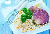 picture of scallops  - rice with scallop on plate and on a table - JPG
