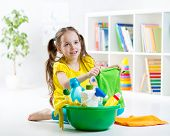 picture of cleanse  - Cute kid little girl cleanses a floor in children room - JPG