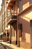 picture of wrought iron  - lace elegant balcony on the street in the old town with beautiful wrought - JPG