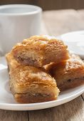 stock photo of baklava  - baklava close up on white plate on wooden table - JPG