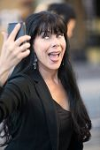 picture of snob  - Beautiful mature woman snaps a selfie on the street - JPG