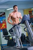 pic of treadmill  - Man in the gym - JPG