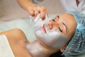 picture of facial  - Girl with a beautician at spa salon - JPG