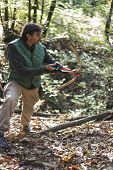stock photo of longbow  - longbow man practicing archery in a forest - JPG