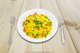 picture of boil  - White dish with boiled rice cooked with turmeric with boiled vegetables  - JPG