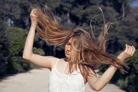 picture of hair blowing  - Photo of beautiful woman with magnificent hair - JPG