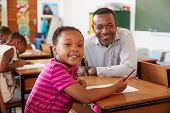 Black teacher and elementary school girl smiling to camera poster