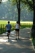 Couple Jogging In Central Park
