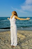 Beautiful Woman Relaxation Exercise On Beach