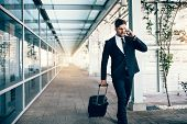 Travelling Businessman Making Phone Call poster