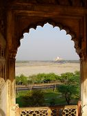 Taj Mahal In Window On Horizon. Agra Fort. India.