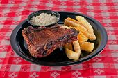 Bbq Ribs Plate On Red Tablecloth