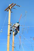 a couple of linemen working on power lines