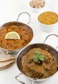 foto of tadka  - Goan chicken chacuti and meat madras served with pilau rice - JPG