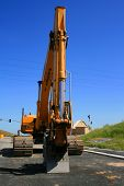 stock photo of oversize load  - Yellow excavator close up on a construction sight - JPG