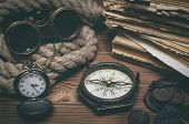 Travel Or Adventure Background. Adventurer Table. Binoculars, Old Books, Mooring Rope, Compass, Anci poster