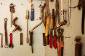 Keys In The Garage Tools. Old Tools Hanging On Wall In Workshop , Tool Shelf Against A Wall  In The  poster