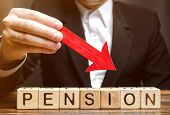 A Man Holds An Arrow Down Over Wooden Blocks With The Word Pension. Fall / Reduction Pension Payment poster
