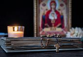 The Time For Prayer. Wooden Rosary On An Ancient Prayer Book. Icon Of The Mother Of God And Jesus. L poster