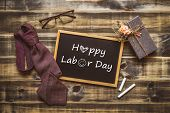 Happy Labors Day Concept. Flat Lay Image Of Gift Box, Necktie, Glasses And Chalkboard With Happy La poster
