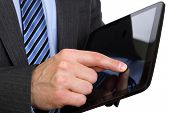 stock photo of tablet pc computer  - Businessman finger touching screen on tablet - JPG
