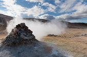 Smoking Fumarole Near Hverir Geothermal Area, Myvatn Lake Area, Iceland. Geothermal Area With Smokin poster