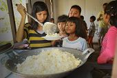 KO CHANG, THAILAND - JANUARY 6: Unknown children get food at lunch time at school by project Cambodi