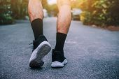 Man Run On The Street Be Running For Exercise,run Sports Background And Closeup At Running Shoe poster