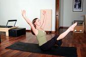 Professional Pilates Instructor Doing Floor Excercises