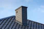 chimney and roof of modern building poster