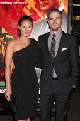 LOS ANGELES - JAN 25:  Cassandra Jean, Stephen Amell arrives at  the
