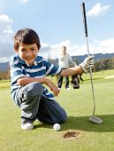 picture of golf  - Young boy playing golf at the club - JPG