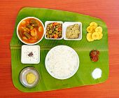 Traditional Southern-indian Meals On Plantain Leaf